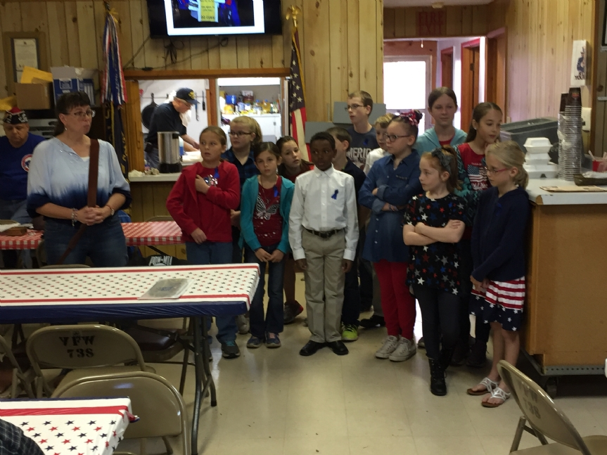 Julie Dueker, VFW Post 738's Teacher of the Year for 2016, and the Young Patriots Club, doing Patriotic Songs at a recent meeting at the Post