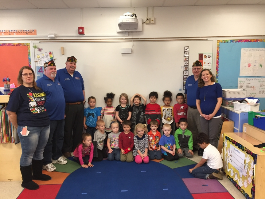 Mike, Jake and Travis with the Head Start Class after handing out hats and gloves